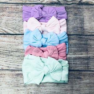 Set of 5 infant nylon bow headwraps; pastel tones